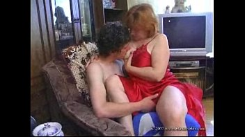 Handjob by mature redhead with long french nails